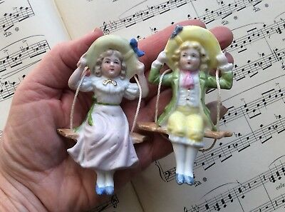 Tiny Pair Antique German Porcelain Bisque Swinger Clock Doll Shade/Oil Lamp Pull