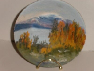 7 inch gold pan, with hand painted, signed mountain scene