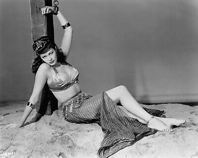 """YVONNE DE CARLO chained to a stake  sexy leggy busty """"Slave Girl"""" pinup photo"""