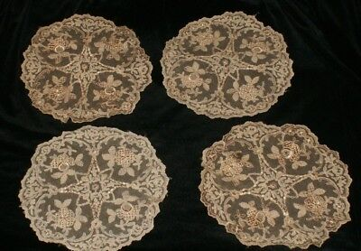 Four beautiful antique embroidered mats/doillies.