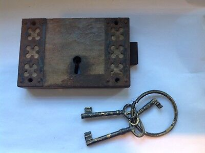 Old wood and wrought iron lock and mismatched keys