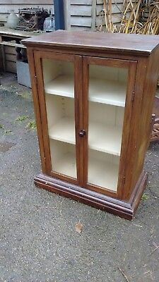 Vintage cupboard with glass doors