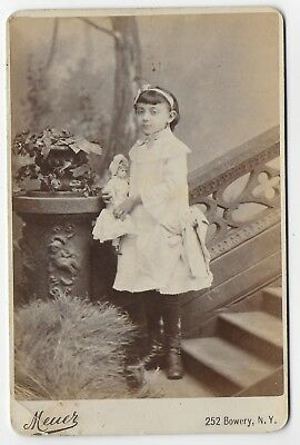 Cute Child Poses With Toy Doll Old Victorian Cabinet Photo