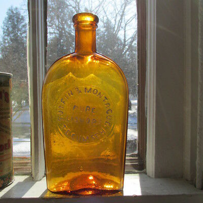 Tecumseh, Mich. Sutfin & Montague Pure Liquors AMBER Strap Sided Whiskey Flask