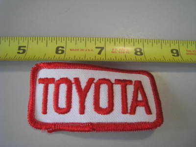 Vintage uniform patch TOYOTA red and white unused new old stock n-mint+ cond