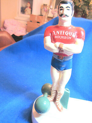 Vintage Antique Bourban Advertising Back Bar Display Weight Lifter Figure
