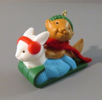 "Avon Winter Pals ""Rabbit and Squirrel Sled Riding"" Ornament"