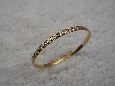 Goldtone Fish Eye Etched Bangle Bracelet (D30)