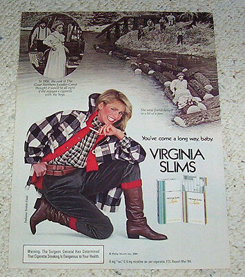 1985 ad page - Virginia Slims cigarettes Girl smoking Great Northern Lumber Camp