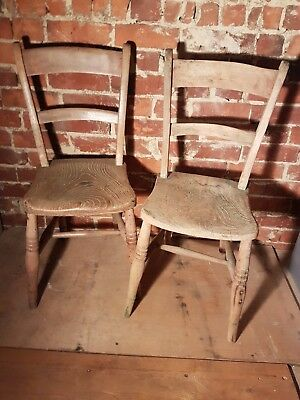 Two antique early farmhouse chairs in light wood