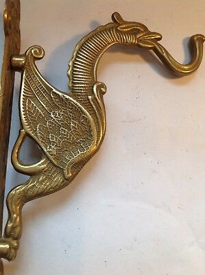 A stunning antique brass Gothic winged dragon griffin hook
