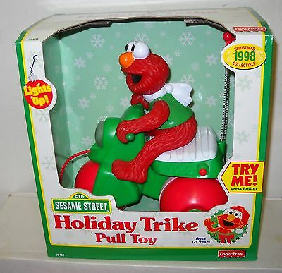 #2692 Fisher Price Target Stores 1998 Sesame Street Elmo Holiday Trike Pull Toy