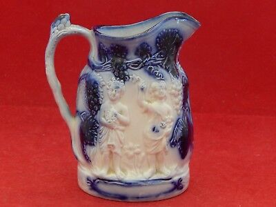 MOLDED FLOW BLUE PITCHER WITH GRAPE PICKERS,GRAPES AND VINES.19th.CENTURY