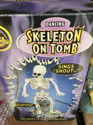 Dancing & Singing Skeleton Sitting on Tombstone Halloween Toy by Gemmy