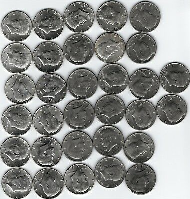 32 Kennedy Half Dollars, 5-1964 90% Silver 11- 40% Silver for a total 3.42 troy