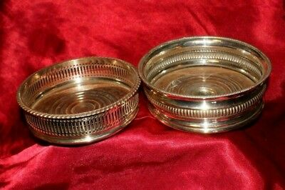 Two Edwardian silver plate wine coasters.