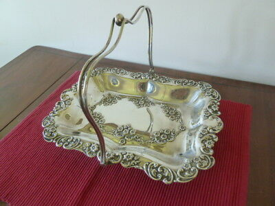 Vintage decorative silver plated tray with handle and feet.
