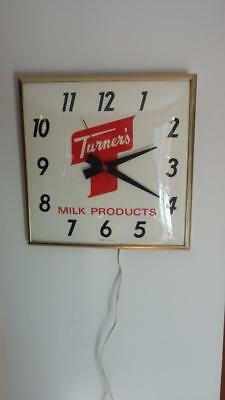 7069----vintage Turner's Milk electric clock -- fine running condition