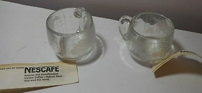 Pair Vintage Nescafe coffee Clear glass etched World cups Unique globe design