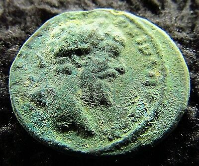Ancient Roman Bronze Coin of Septimius Severus circa 193 - 211  AD  (1303+)