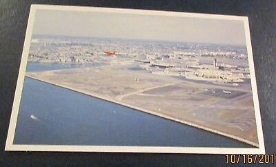 Postcard..<Commercial Jet Aircraft>LOGAN INTERNATIONAL AIRPORT-<BOSTON>