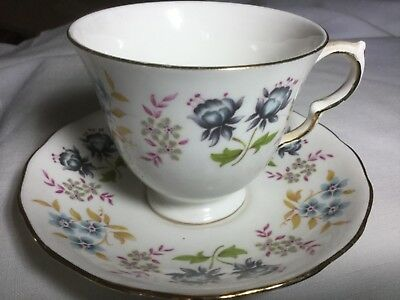 Queen Anne Bone China Cup And Saucer England     White/flower Border