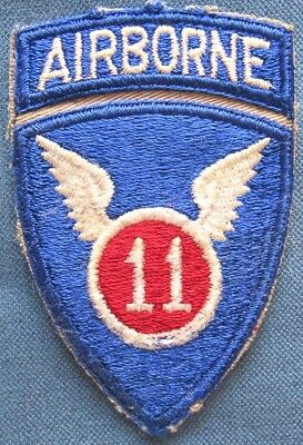 """WWII US Army 11th Airborne Division shoulder patch with attached """"AIRBORNE"""" tab"""