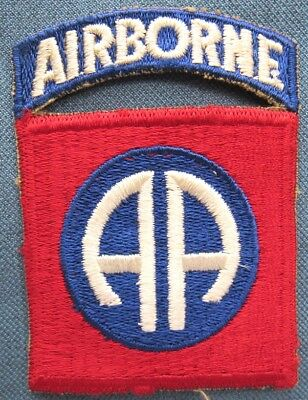 "WWII US Army 82nd Airborne Division shoulder patch with attached ""AIRBORNE"" tab"