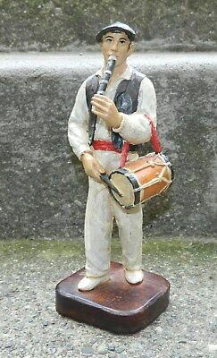 Vintage hand-cut figure in wood of flute-playing man from Spain by. J. Alberdi