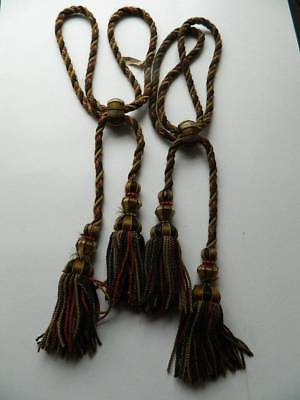 Pair of antique French Chateau silk curtain tiebacks. Black, green & gold