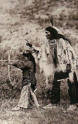 Kicking Bear Sioux Indian Teaches Son Bow & Arrow, Native American --- Postcard