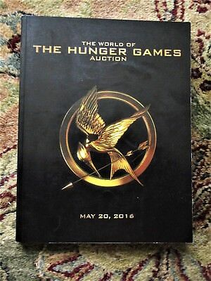 THE HUNGER GAMES Auction Catalog PROPS SETS COSTUMES WEAPONRY from all 4 FILMS