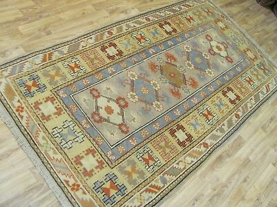 A LOVELY OLD HANDMADE MILAS WOOL ON WOOL TURKISH RUG (215 x 118 cm)