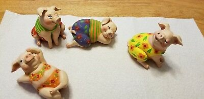 4 Pig Figurine Relaxing