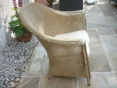 Antique stunning Lloyd Loom armchair with sprung seat believed 1884 Gold