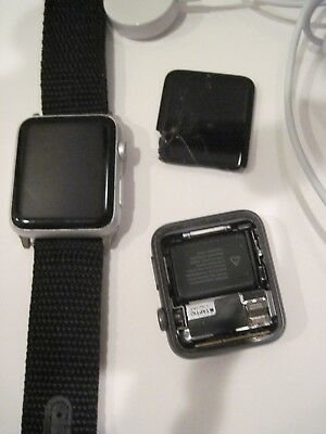 Apple Watches  Series 7000 42mm w/ Black Band + Charger - BOTH 7000 - 1 damaged