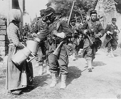Peasant woman giving water to marching French troops 1914 World War I 8x10 Photo