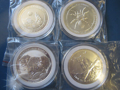 4 Silver Bullion Coins In Capsules Funnel Spider Puma Koala Howling Wolf Lot 38