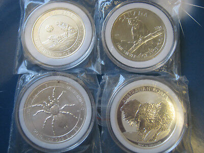 4 Silver Bullion Coins In Capsules Spider Puma Koala Howling Wolf Lot 42