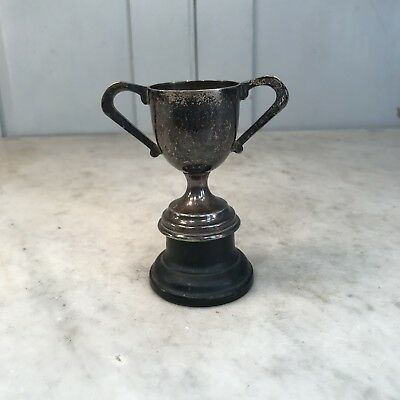 Antique small silver plated trophy on metal plinth