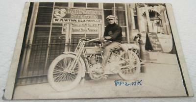 RPPC Harley Davidson Motorcycle In Front Of Harley Store in Blairsville Pa 1910s