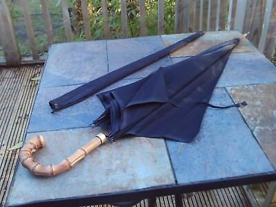 Antique umbrella with gold coloured band marked KENDALL and bamboo crook handle