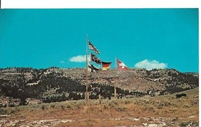 Vintage postcard Flags of U.S.S. and Wyoming, by Girl Scouts