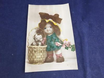Vintage Novelty Postcard Moving Eyes Girl with Puppy in Basket.