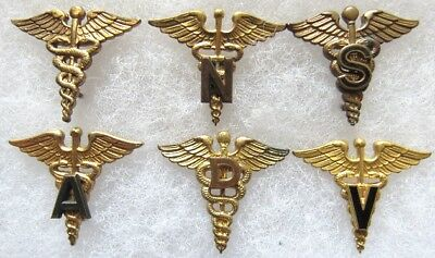 Lot of 6 AMEDD officer branch insignia: MC, ANC, Sanitary & Admin Corps, DC, VC
