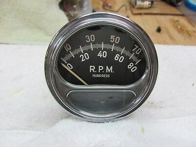 vintage Sun FZ-88 8K tachometer used with mounting cup
