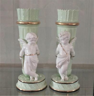 Pair of Antique Minton Carrier Belleuse Celedon Glazed Vases with Chained Puttis