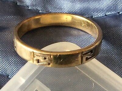 14K Two Tone Gold Wedding Ring Greek Knot Design In White Gold Over Yellow. Worn