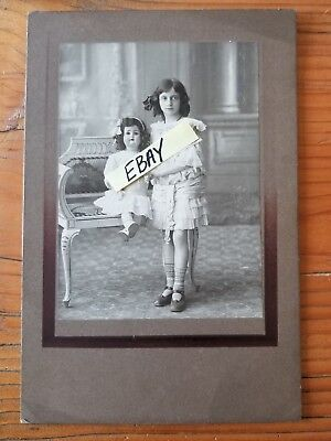Early 1900s photo adorable girl posed with her precious doll cabinet card