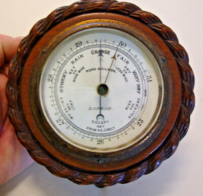 Early 20th century carved oak case wall barometer by NORIE & WILSON London